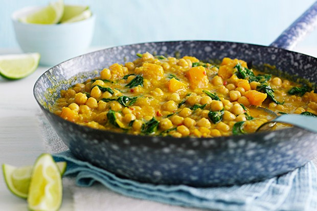 Chickpea and squash coconut curry in a grey pan