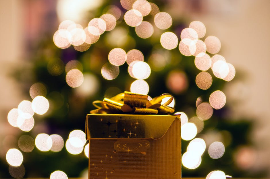 Gold-colored Gift Box With White Bokeh Background