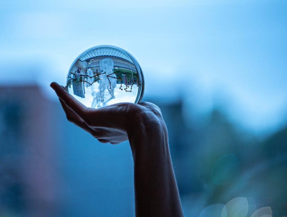 Hand holding a glass ball