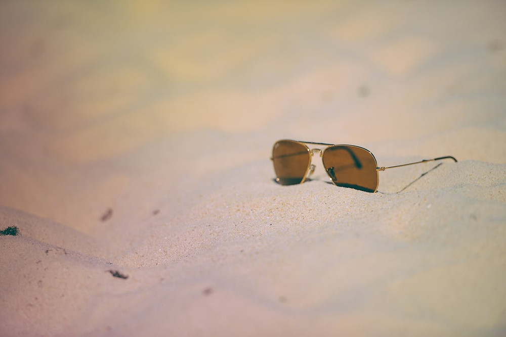 Rule of Thirds Photography of Brown Sunglasses on Sand