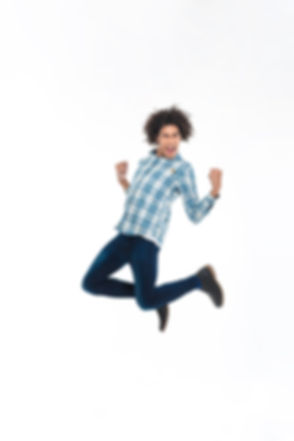 Full length portrait of a cheerful afro american man jumping isolated on a white background_