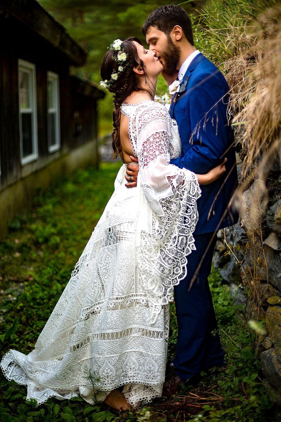 Boho Bride and Groom Kissing
