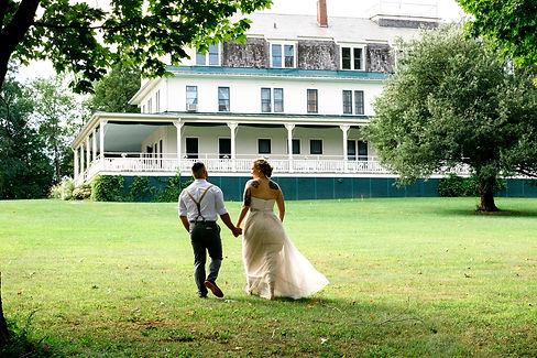 Bride and Groom Walking Grand Isle Lake