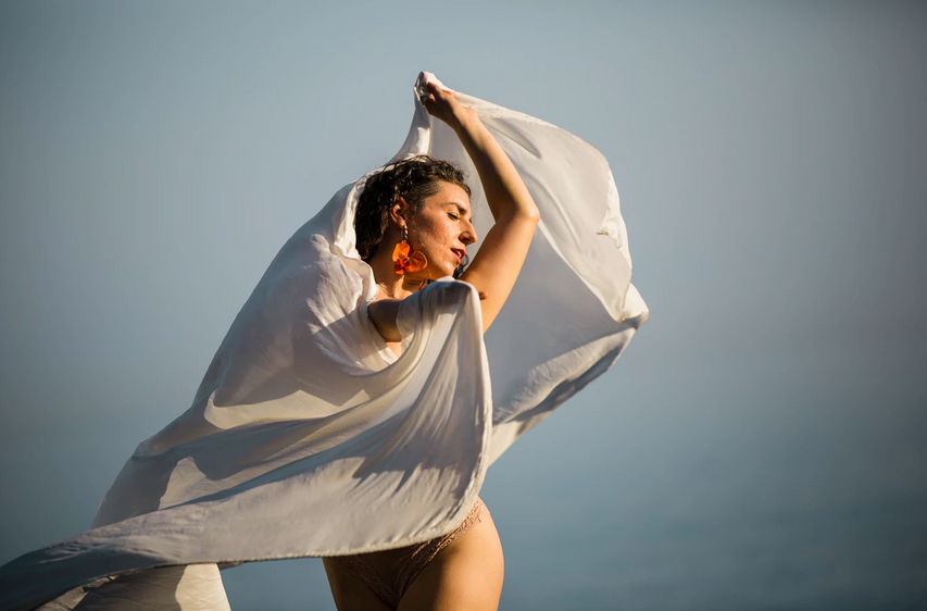 Dancer with white fabric, Bali.png