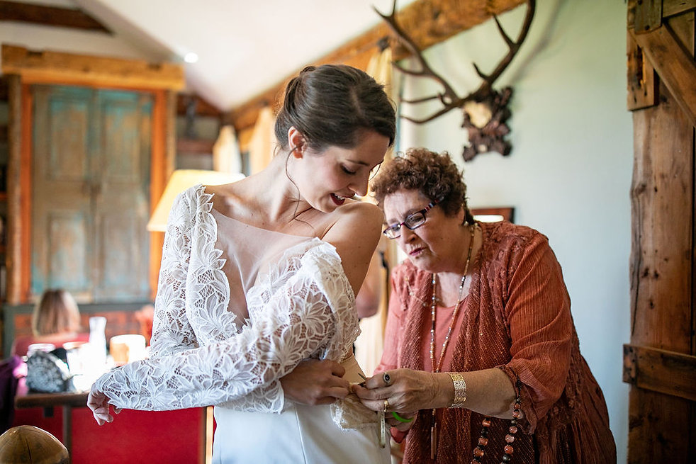 Bride Getting into Dress with Help from
