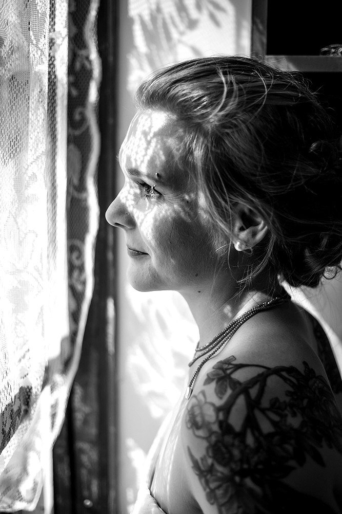 Bride Looking Out Lace Window