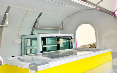 Sliding display freezer