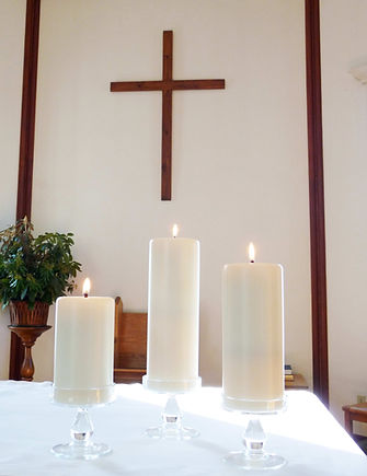 Candles w Cross in Background.jpg