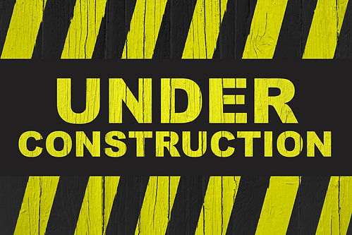 Under construction warning sign with yel