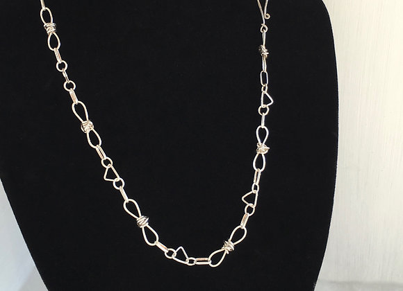 "Knotted links and triangles 24"" long handmade chain."