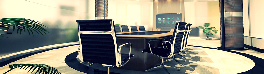 A modern boardroom with video conferencing facilities