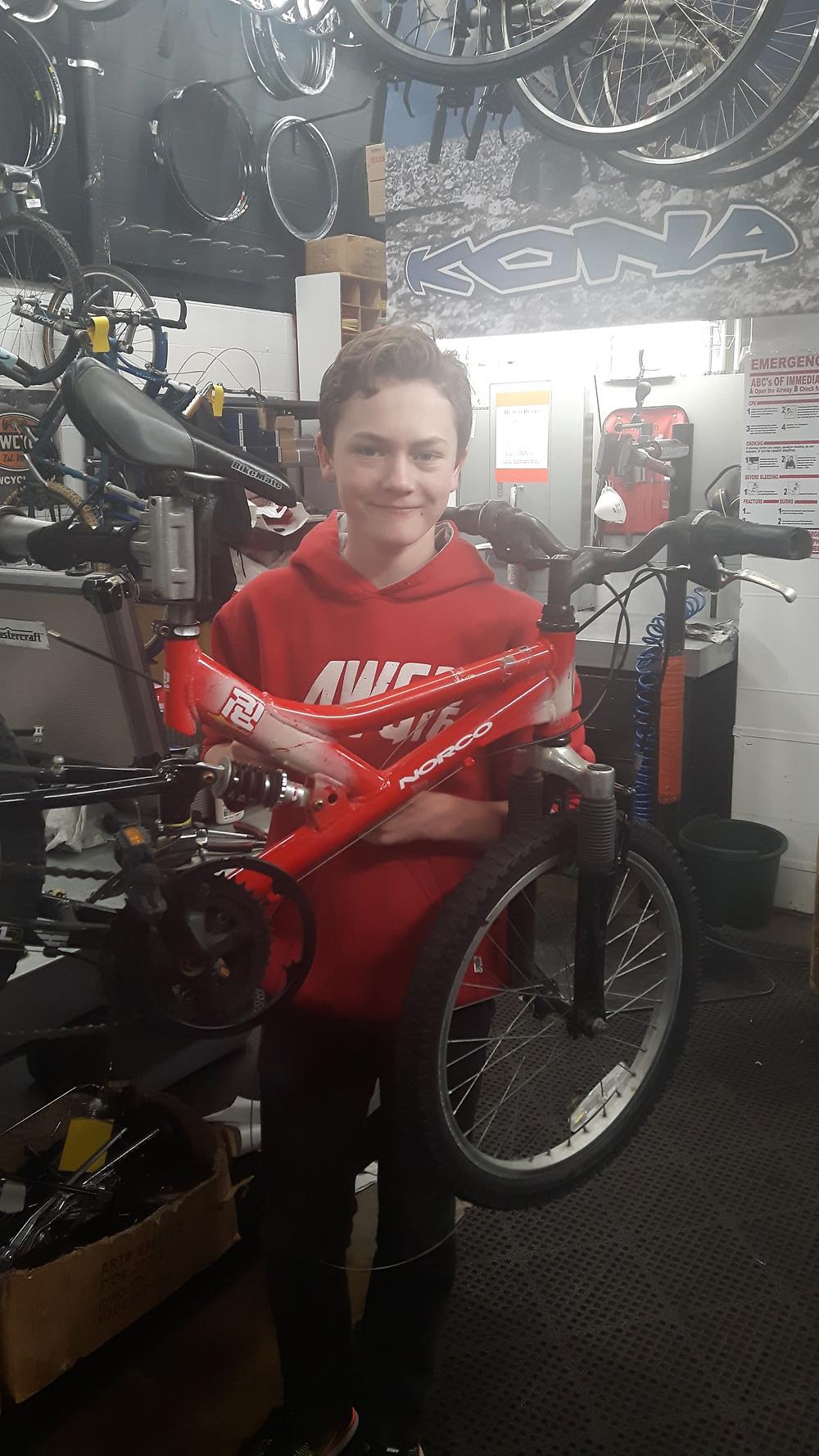Coen working on repairs #BowCycle #Kona #Bikesforkids