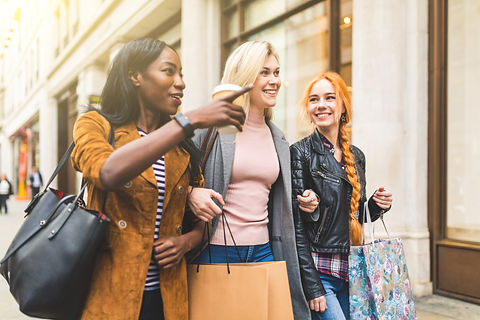 Multiracial group of women shopping and