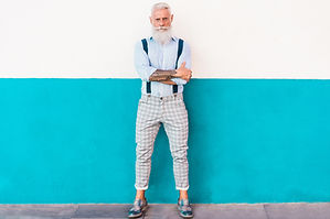 Senior hipster man posing with trendy wa