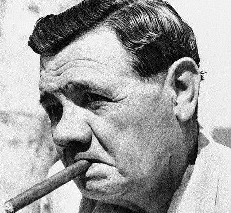 Babe Ruth smoking a cigar