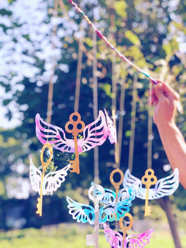Magical enchanted keys floating in the breeze, inspired by Harry Potter and the Philosopher's Stone