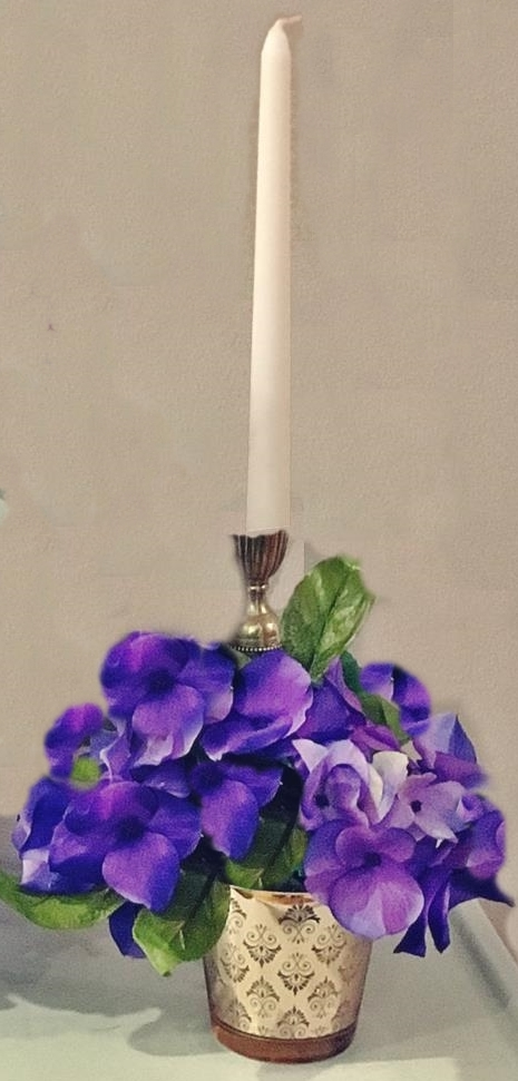 Purple pumpkin candle and gold votive holder