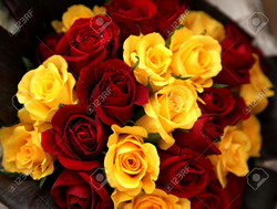 10444800-a-wedding-bouquet-of-gold-and-red-roses-Stock-Photo