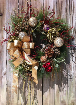 Traditional gold bowed, sparkle ornaments, with pinecones and assorted dried berries and twigs
