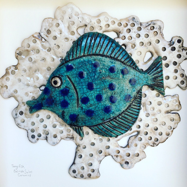 Spotty Tang on Coral Raku fired ceramic picture