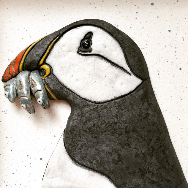 Ceramic framed Puffin with sand eels