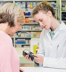 female-pharmacist-talking-to-older-coupl