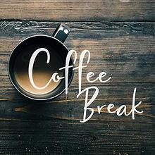 Coffee-Break-cup-on-wood-table.jpg