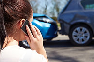 Motor vehicle accident with a woman on the phone filing an insurance claim