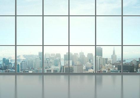 Вид из панорамного окна на современный город