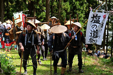 Men in Traditional Costume Hike Along th