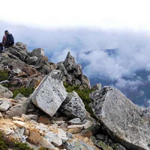 A Solo Hiker Resting on the Summit, Nagano