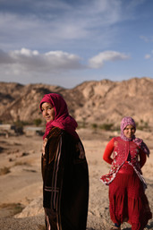 Gawaher and her neighbor play in the mountains across their village at Altarfa.