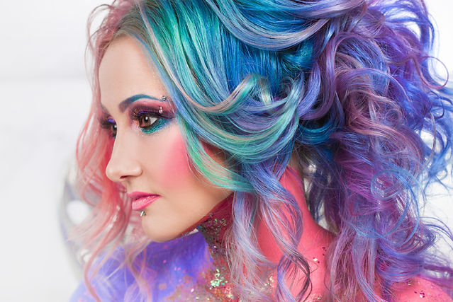 Beautiful woman with bright hair. Bright