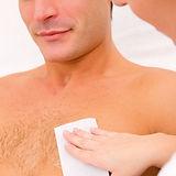 Man waxing his chest hair.jpg