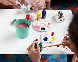 hands painting on white plaster.jpg
