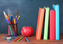Composition of books, stationery and an