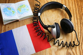 language course headphone and flag on wo