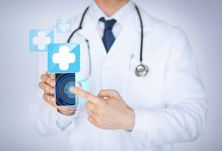 depositphotos_27050233-stock-photo-doctor-holding-smartphone-with-medical.jpg