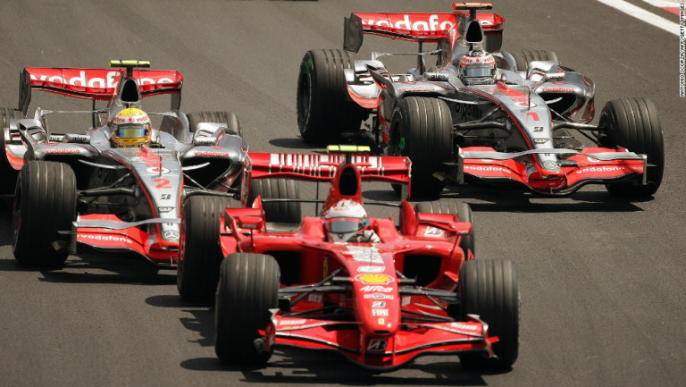 Hamilton on track with Alonso at the season conclusion to 2007 in Brazil. Both drivers would miss out on the title to Ferrari's Kimi Raikkonen (pictured) by a solitary singular point.