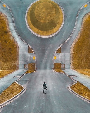 abstract-image-of-man-standing-in-road.j