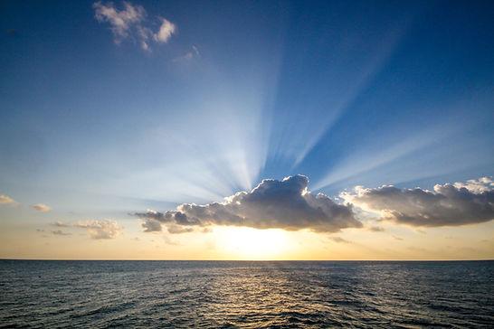 sun-setting-over-ocean.jpg