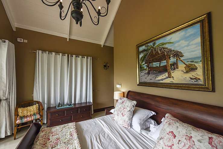 Beautifully styled bedrooms at Coconut Climb, Seychelles.