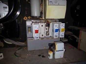 Replacing customer's burnt out circuit breaker