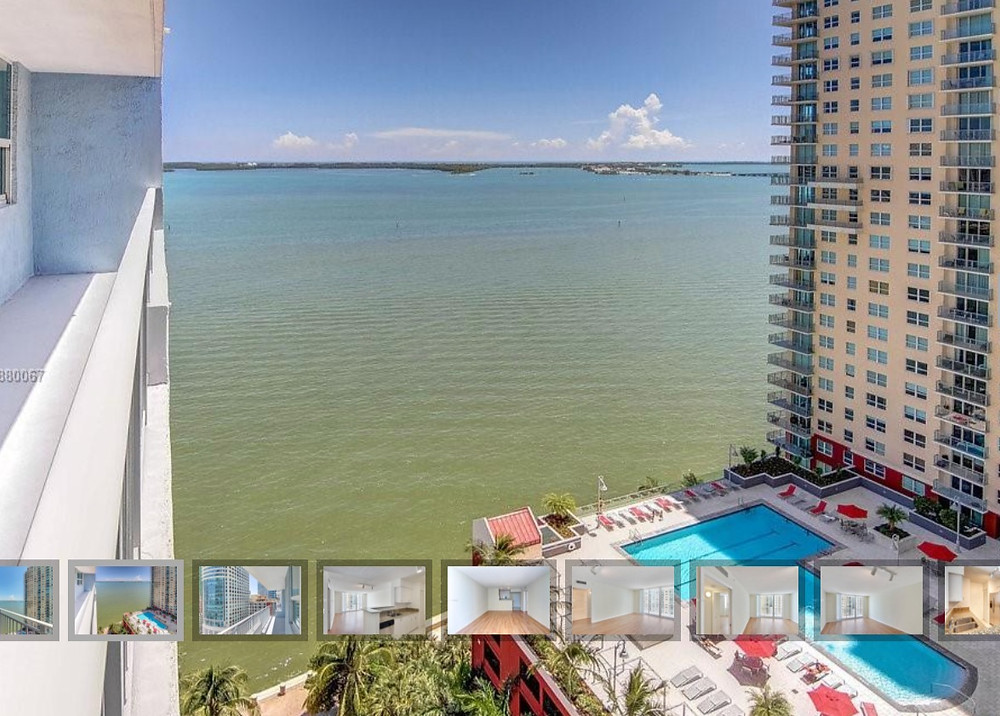 Water view from a high apartment in Brickell in downtown Miami, pool below