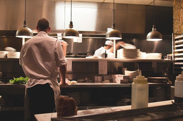 Generic shot of chefs inside of a large kitchen
