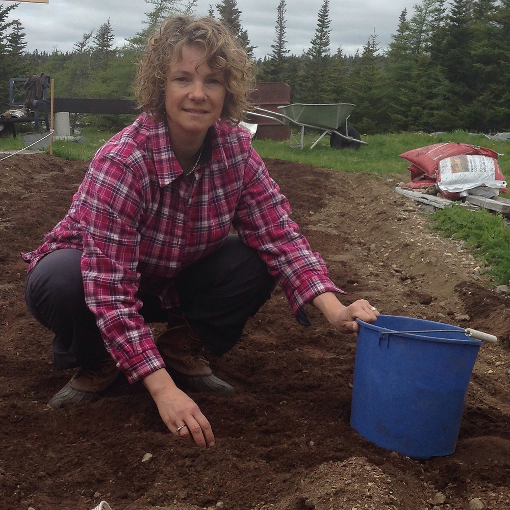 Here's a picture of me last year as we were prepping the soil and planted our crop for the season on May 24th weekend