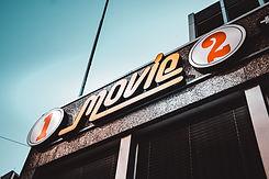 1-movie-2-signage-under-white-clouds-120