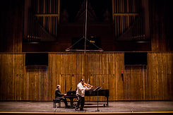 man-playing-grand-piano-on-stage-3042512