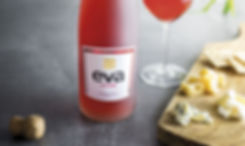 Eva joven bottle with a table of cheese