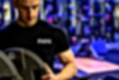 Personal training client wearing black Kano Health and Fitness t-shirt during a sessin
